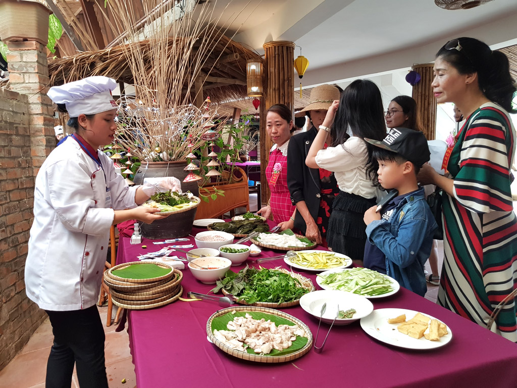 Visitors enjoy cuisine of many regions at the opening ceremony.