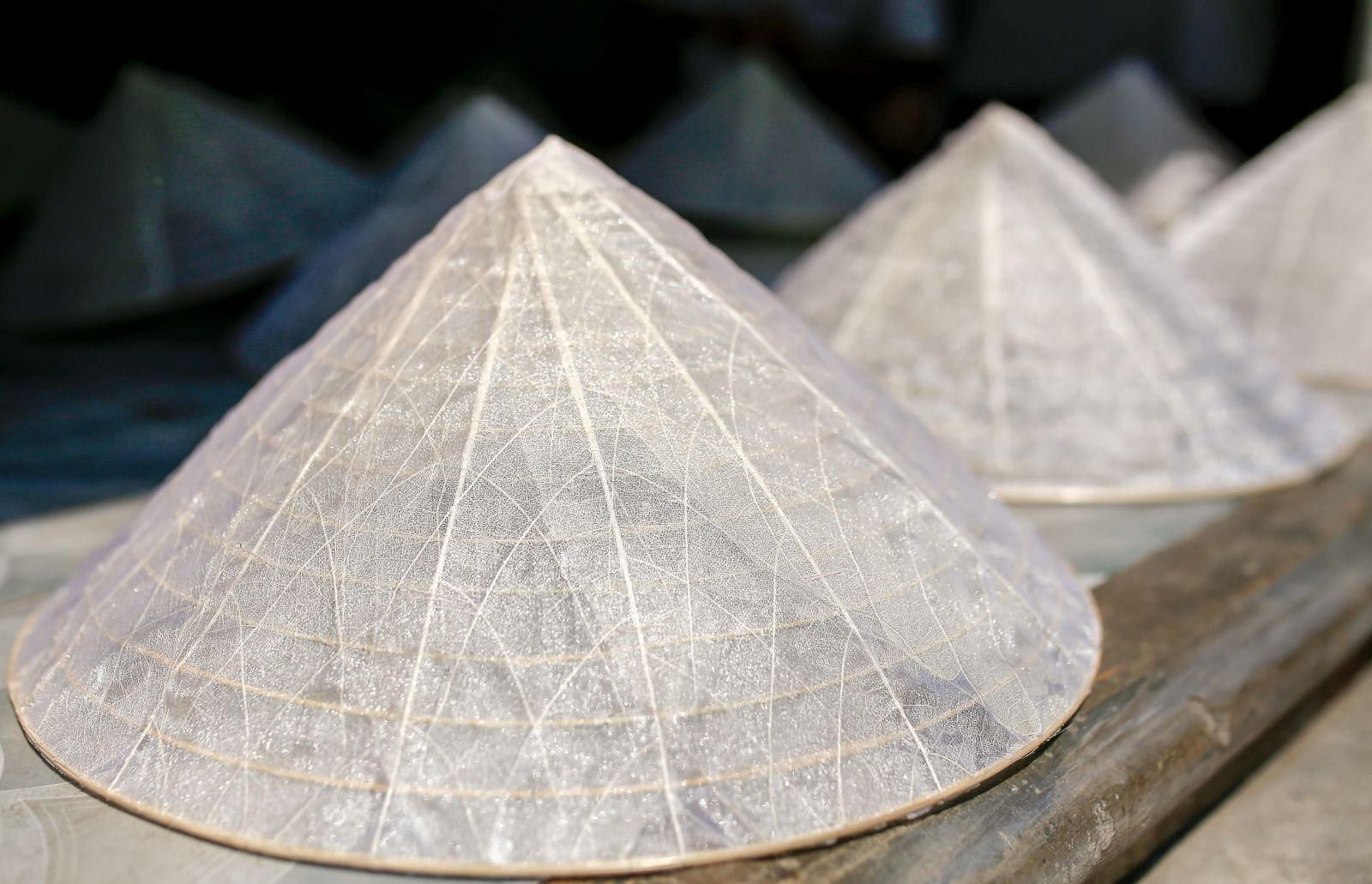 The transparent leaf veins conical hats are finished, with their strange beauty of elegance and luxury.
