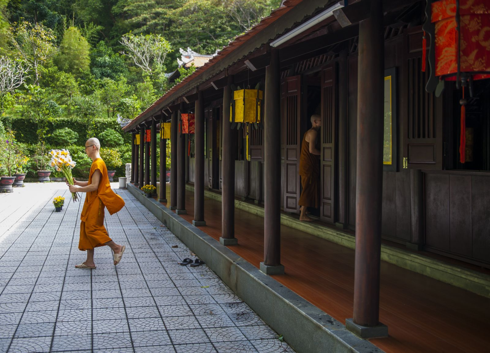 The monks decorating the flowers for the front hall