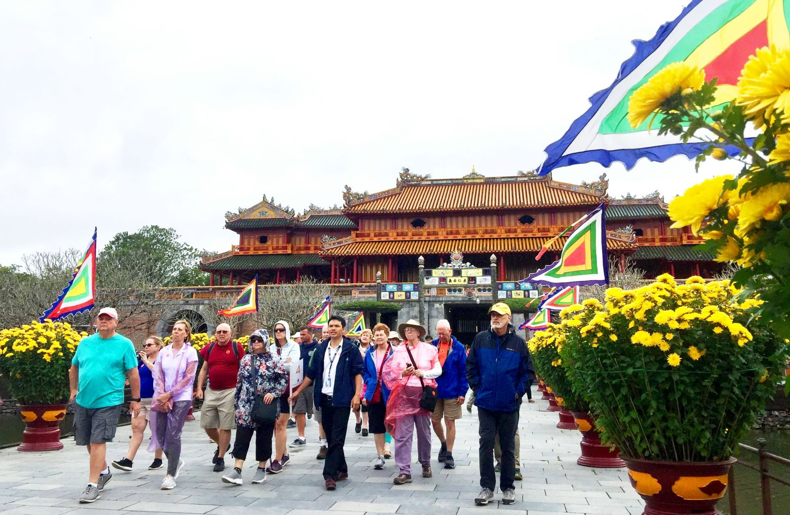 Tourists coming to Thai Hoa palace in a winter day to enjoy the