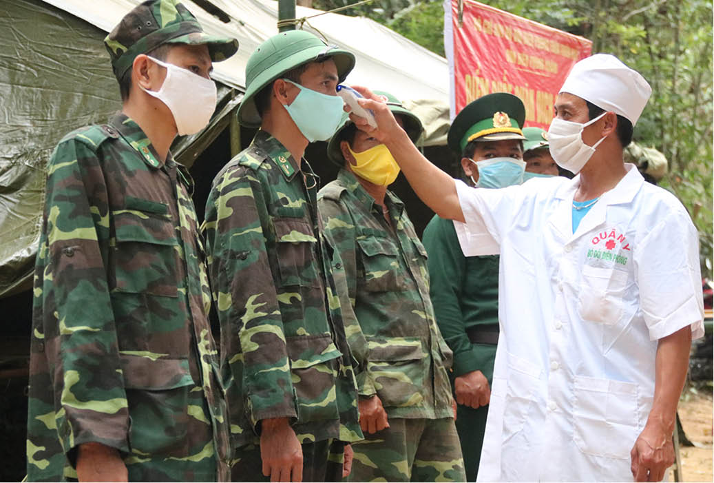 Every morning, army medical corps measure the body temperature of the soldiers
