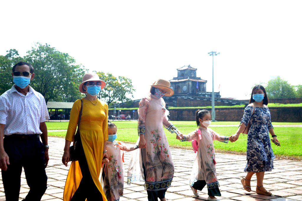 After the days at home, many tourists choose to wear ao dai during this holiday