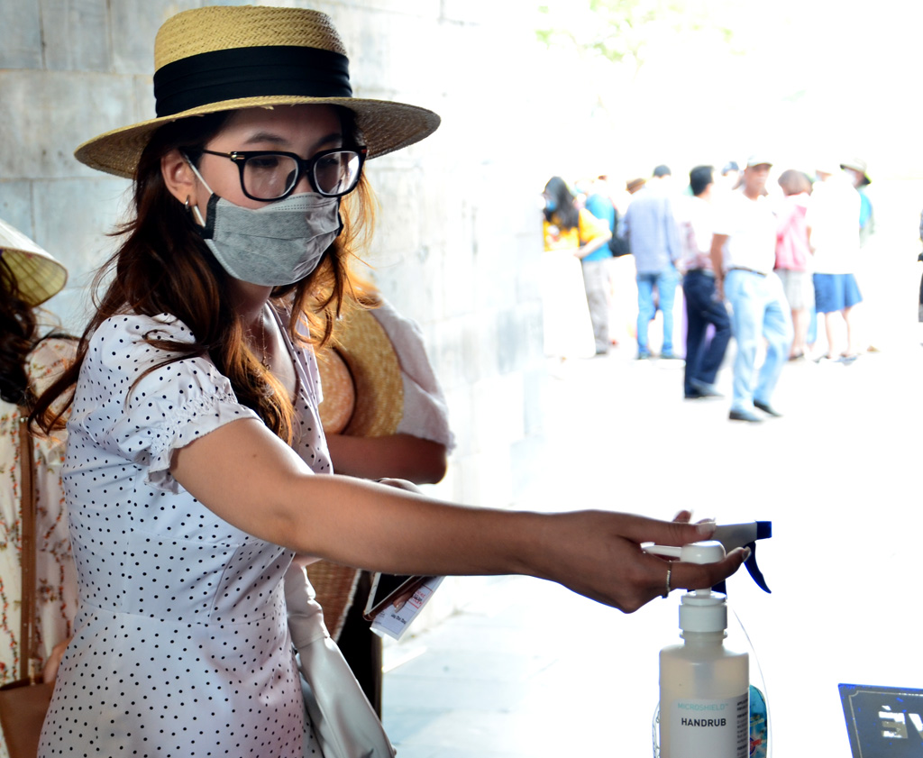 Disinfecting hands before visiting the heritage