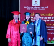 Presenting diplomas to students mainly taught  in English
