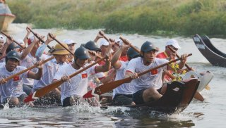 Watching boat racing held for the first time on Nhu Y River